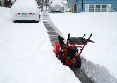 101443380-snow-removal-on-driveway-after-blizzard-in-residential-district-1